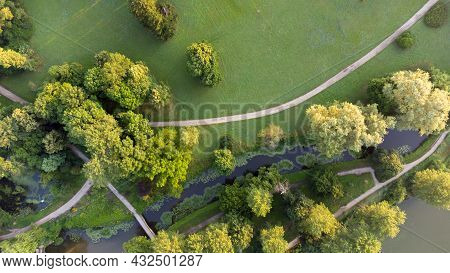 Top View Dirt Paths In The Park In Summer. Green Trees, Glades, Lakes
