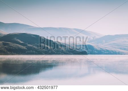 Lake In The Mountains In Misty Morning. Fog Above The Surface Of The Lake. Winter Landscape. Bannoye