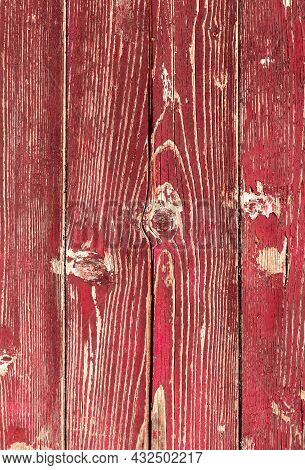 Wooden Red Planks. Background Consisting Of Wooden Planks With Peeling Red Paint.