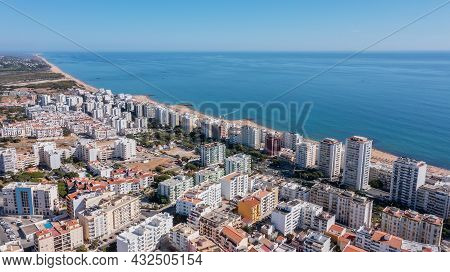 Beautiful Aerial Cityscapes Of The Tourist Portuguese City Of Quarteira. On The Seashore During The