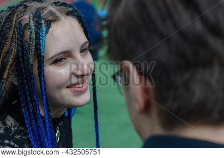 A Happy Young Woman And A Young Man. Laughing Heterosexual Couple In Love Outside. Funny Young Adult