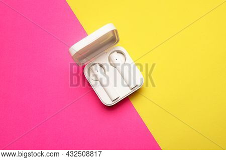 Wireless Headphones On A Pink Background . Bright Background. White Headphones. Bluetooth Headset. P