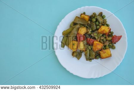 Photo Of Matar Paneer Mix Veg (indian Food) On White Plate Isolated Over Light Blue Background With