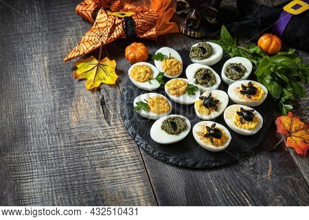 Halloween Funny Idea For Party Food. Halloween Creative Set Stuffed Eggs On A Wooden Table. Copy Spa