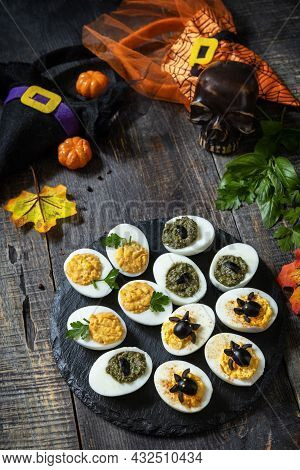 Halloween Funny Idea For Party Food. Halloween Creative Set Stuffed Eggs On A Wooden Table.
