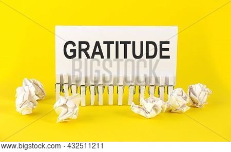 Text Gratitude On White Short Note Paper Yellow Background