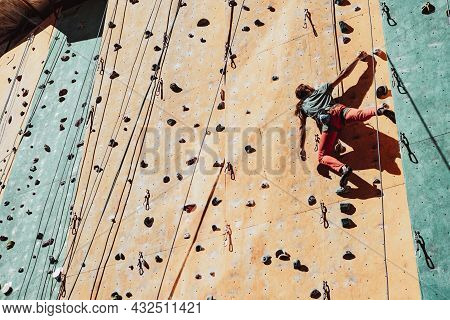 One Caucasian Man Professional Rock Climber Practicing Alone At Training Center In Sunny Day, Outdoo