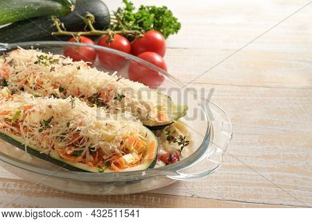 Preparing A Vegetarian Low Carb Diet Meal From Zucchini Filled With Vegetables, Feta Cheese And Parm
