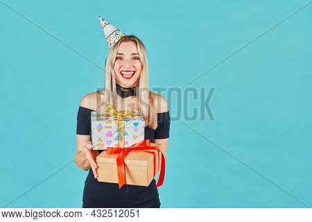 Woman With A Present. Happy Girl With A Gift. Beautiful Happy Girl With Gift Box At Celebration Part