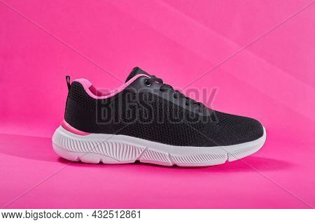 Female Sneakers For Run On Pink Background. Fashion Black Stylish Running Shoe, Sneaker Or Trainer.