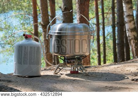 Camping Food Making. Tourist Foods In Outdoor Activities. Food In Bowler In The Green Forest.