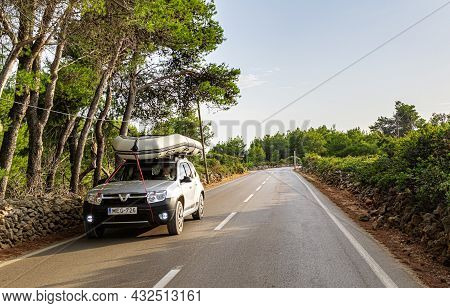 Vir, Croatia - July 27, 2021: Dacia Duster On The Road With A Boat On The Roof At The Island Of Vir,