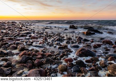 Beautiful Golden Sunset Over The Rocky Sea. Waves Are Reaching To Coast During Sunset At Tahkuna, Hi