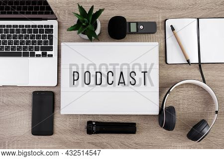 Podcast Concept - Flat Lay Background, Close Up Of Lightbox With Podcast Word On The Table With Lapt