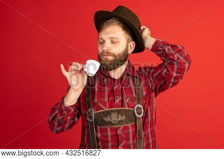 Comic Portrait Of Bearded Man, Waiter In Hat And Traditional Bavarian Costume Isolated Over Red Stud