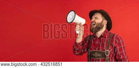 Comic Portrait Of Bearded Man, Waiter In Hat And Traditional Bavarian Costume Shouting At Megaphone