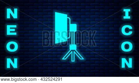 Glowing Neon Studio Light Bulb In Softbox Icon Isolated On Brick Wall Background. Shadow Reflection