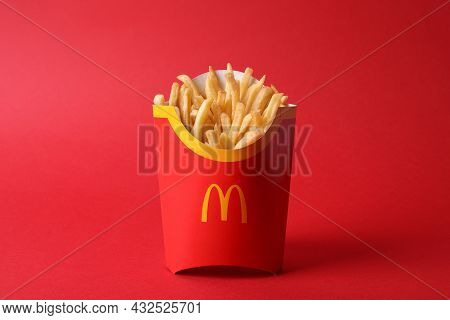 Mykolaiv, Ukraine - August 12, 2021: Big Portion Of Mcdonald's French Fries On Red Background