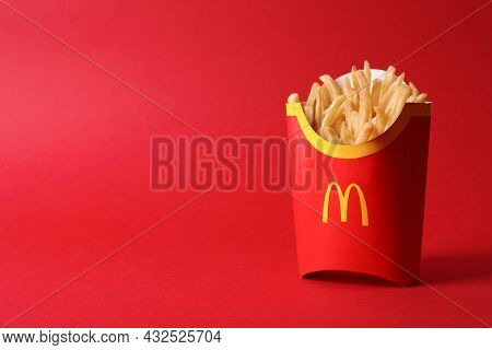 Mykolaiv, Ukraine - August 12, 2021: Big Portion Of Mcdonald's French Fries On Red Background. Space
