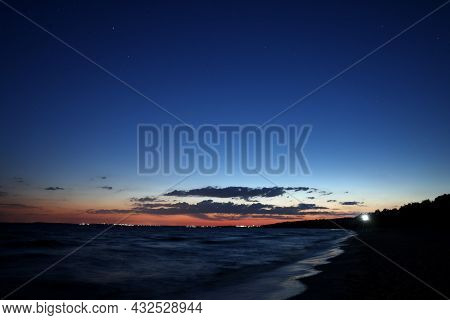 Picturesque View Of Beautiful Sunset On Seaside At Night