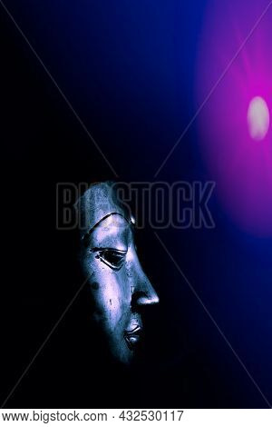 Spiritual Enlightenment. Mindful Buddha Face Mask With Ethereal Blue And Pink Light. Modern Buddhism