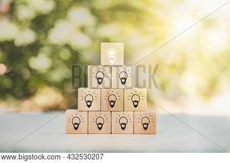 Wooden Cube Block Tower With Light Bulb Icon On White Background, Conceptual Of Creative Idea And In