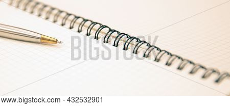 Close-up Office Work Equipment Notebook Or Note Book Diary With A Pen On Wooden Desk Or Boardroom Ta