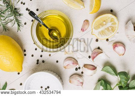 Close Up Shot Top View Olive Oil Surrounded By Cooking Ingredients. High Quality Beautiful Photo Con