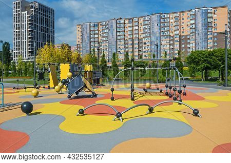 Visibility Of Colorful Large Playground In City Park. Empty Modern Outdoor Playground In Springtime.