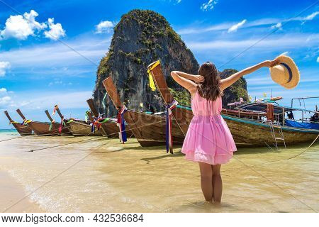 Beautiful Tourist Woman Near Traditional Longtail Boat In Phra Nang  Beach, Thailand