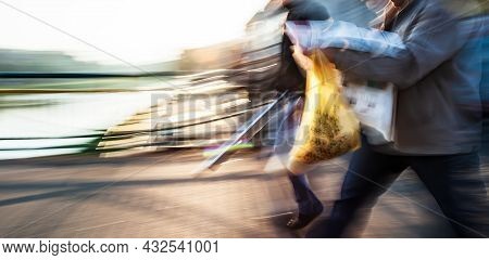 Abstract Image Of People In The Street With A Blurred Background. Intentional Motion Blur.