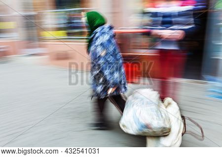 Abstract Image Of People In The Street With A Blurred Background. Intentional Motion Blur. An Elderl