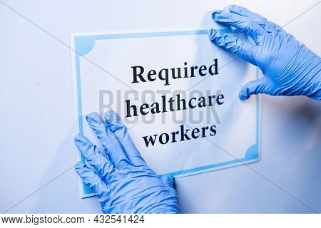 Doctor Or Nurse Pasting Required Helathcare Workers Infront Of Hospital Door During Coronavirus Or C
