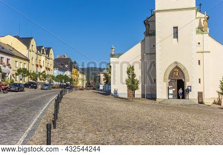 Kasperske Hory, Czech Republic - September 20, 2020: Cobblestoned Street With Church And Old Houses