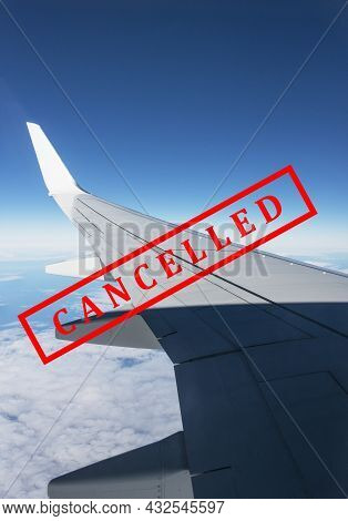 Flight Cancellation. Commercial Airplane Flight Over The Clouds With Red Stamp Text Trip Cancelled F