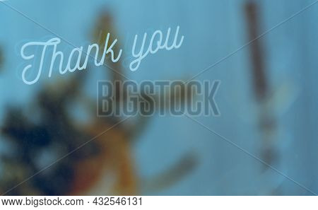 Words Thank You On Window Glass With Copy Space. Thank You Concept.