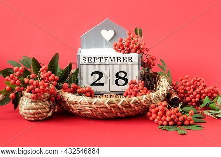 Calendar For September 28 : The Name Of The Month In English, Cubes With The Number 28 On A Decorati