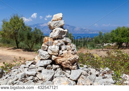 A Cairn Marking A Mountain Route, A Man-made Pile Of Stones For Trekking Navigation