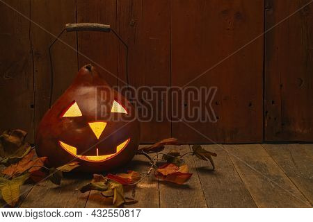 Lighted Decorative Gourd Pumpkin With Metal And Wood Handle.