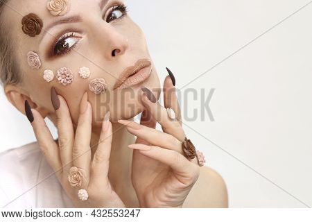Beautiful Beige-brown Makeup And Manicure On Long Nails.