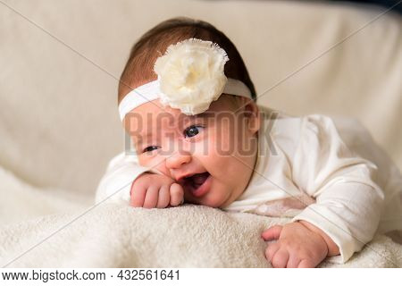 Childhood, Motherhood, Emotions, Fashion Concepts - Cute Smiling Happy Chubby Baby Close Up Little G