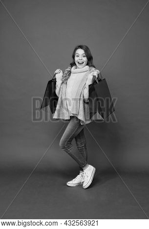 Happy Small Shopaholic With Fashion Look Carry Shopping Bags Red Background, Shopaholism