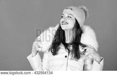 Warm And Cozy. Girl Wear Winter Jacket Blue Background. Winter Season Of Contrasts. Woman Wear Down