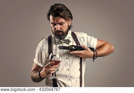 Enjoy The Taste. Bearded Man In Suspenders Drink Red Wine. Brutal Guy Bartender In Bow Tie. Elegant