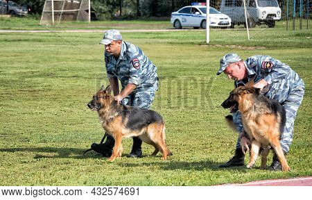 Police Officers Training A Sniff Dog For Finding Drugs, Weapons, Explosives: Abakan, Russia - August