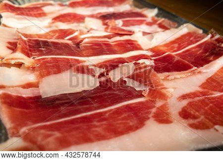Slices Spanish Dried Pork Also Known As Jamon Serrano. Typical Tapa Iberian Ham