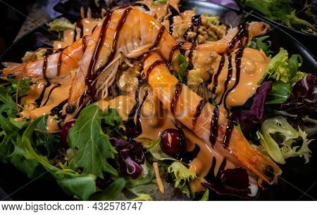 Healthy And Fresh Salad With Shrimps And Vegetables Serving Plate At Restaurant