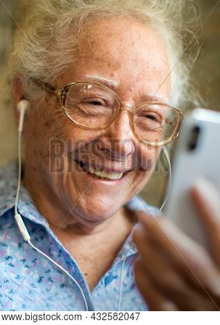 Senior woman smiling in video call in the new normal