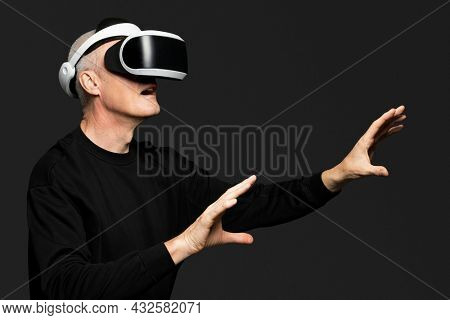 Mature man experiencing VR entertainment technology
