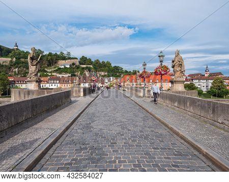 Wuerzburg, Bavaria, Germany - August 3 2021: Alte Mainbruecke Or Old Main Bridge In Wuerzburg,  Fran